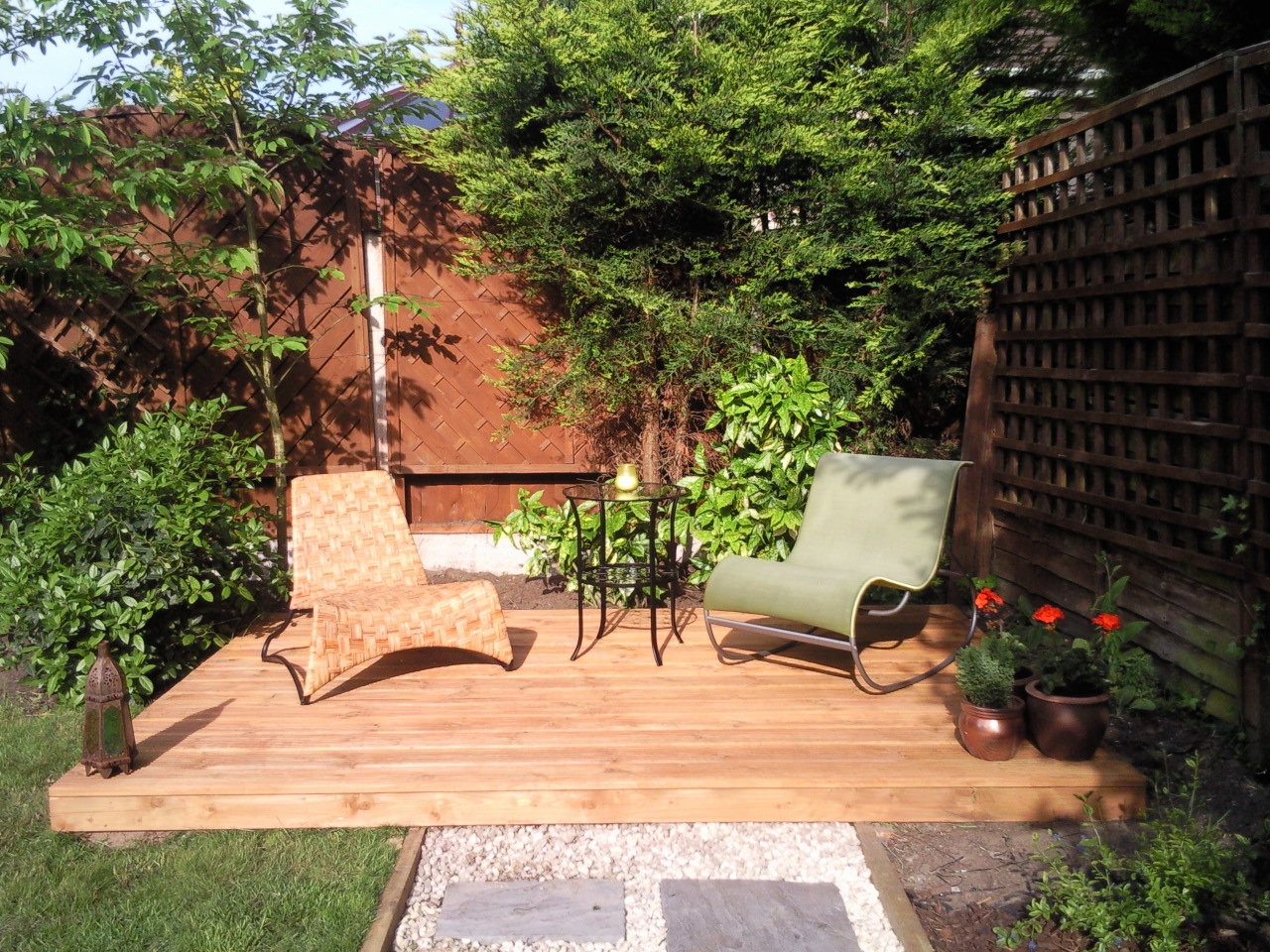 Landscape gardening south east london garden design for Garden design decking areas